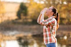 woman-shouting-nature-beautiful-young-to-autumn-outdoors-42999000.jpg